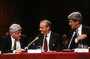 National Security Advisor Anthony Lake talks with Senator Ted Kennedy and Senator John Kerry before the Senate Intelligence Committee hearing on his nomination as Director of the CIA March 11, 1997.