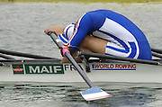Munich, GERMANY, 2006, FRA 3 M2X Bow Cedric Berrest, stretch's before the heat.   FISA, Rowing, World Cup,  on the Olympic Regatta Course, Munich, Fri. 26.05.2006. © Peter Spurrier/Intersport-images.com,  / Mobile +44 [0] 7973 819 551 / email images@intersport-images.com.[Mandatory Credit, Peter Spurier/ Intersport Images] Rowing Course, Olympic Regatta Rowing Course, Munich, GERMANY