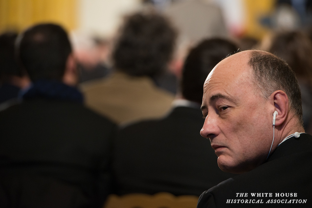 2/11/2014 -- East Room, White House -- An attendee listens to speeches by President Barack Obama and French President Françoise Hollande during the French President's State Visit to the White House.