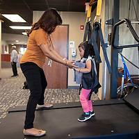 Maranda Yazzie, a physical therapy assistant uses a high performance treadmill to work with Sujey Revuelta, 3, on gait training at Rehoboth McKinley Christian Health Care Services Wellness Center, Thursday, Sept. 27, 2018. The treadmills are multi-functional, from teaching stroke victims or people suffering from orthopedic ailments how to walk again to high speed running mechanics for training.