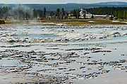 Great Fountain Geyser, with White Dome Geyser in the background at Yellowstone National Park. Great Fountain Geyser is part of the Great Fountain Group along the Firehole Lake Drive in Yellowstone, Wyoming. The geyser is show during summer dry season.