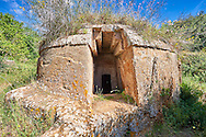 Etruscan circular Tumulus Tomb with Domos (entrance passage), 6th century BC,  Necropoli della Banditaccia, Cerveteri, Italy. A UNESCO World Heritage Site .<br /> <br /> Visit our ETRUSCAN PHOTO COLLECTIONS for more photos to buy as buy as wall art prints https://funkystock.photoshelter.com/gallery-collection/Pictures-Images-of-Etruscan-Historic-Sites-Art-Artefacts-Antiquities/C0000GgxRXWVMLyc