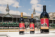 The commemorative 14 Hands Limited Release Kentucky Derby Red Blend wine is shown Wednesday, Apr. 29, 2015, in front of the Twin Spires at Churchill Downs in Louisville, Ky. (Photo by Brian Bohannon/Invision for 14 Hands Winery/AP Images)