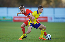 BANGOR, WALES - Saturday, November 17, 2018: Wales' captain Ryan Reynolds (L) and Sweden's Kevin Yakob during the UEFA Under-19 Championship 2019 Qualifying Group 4 match between Sweden and Wales at the Nantporth Stadium. (Pic by Paul Greenwood/Propaganda)