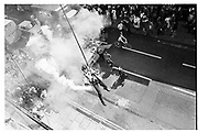 Member of Dangerous sports Club jumping out over Oxford High St. 1983<br /> © Copyright Photograph by Dafydd Jones 66 Stockwell Park Rd. London SW9 0DA Tel 020 7733 0108 www.dafjones.com