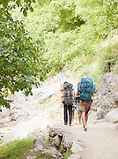 Two hikers set walk a Berber path through the Imlil Valley, in Toubkal National Park, Moroco