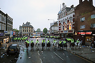 Police horses clearing the streets as they pushed the West Ham United fans back outside Boleyn Ground.scenes around the Boleyn Ground, Upton Park in East London as West Ham United play their last ever game at the famous ground before their move to the Olympic Stadium next season. Barclays Premier league match, West Ham Utd v Man Utd at the Boleyn Ground in London on Tuesday 10th May 2016.<br /> pic by John Patrick Fletcher, Andrew Orchard sports photography.
