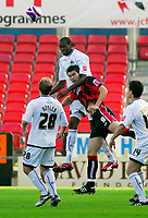 Photo: Leigh Quinnell.<br /> Bournemouth v Swansea City. Coca Cola League 1. 14/10/2007. Swanseas Dennis Lawrence gets an armfull of Bournemouths Sam Vokes as he rises for a ball.