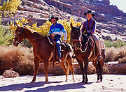 Gayle Houston and R.G. Williams horseback riding in Sevenmile Canyon, Grand County, Utah.