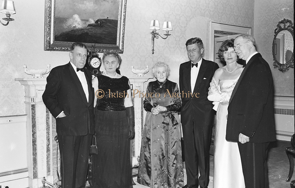 c333 5173<br /> 28.6.63<br /> President Kennedy entertained by President de Valera<br /> <br /> President Kennedy was to-night entertained at a dinner party given by the President of Ireland <br /> Mr. Eamon de Valera at aras an Uachtarain, (the home of the Predsident) Phoenix Park, Dublin. Included in the group are (l-r) An Taoiseach (Premier) <br /> Sean Lemass and Mrs. Lemass, Mrs. de Valera wife of the President , President Kennedy,<br /> Mrs. Eunice Shriver and President de Valera. *** Local Caption *** It is important to note that under the COPYRIGHT AND RELATED RIGHTS ACT 2000 the copyright of these photographs are the property of Lensmen & Associates and they cannot be copied, scanned, reproduced or electronically stored in any form whatsoever without the written permission of Lensmen & Associates.