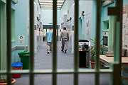 'Enhanced' prisoners walking down the corridor of H wing at the Young Offenders Institution in Aylesbury, Buckinghamshire, United Kingdom. Under the Incentives and Earned Privilege Scheme, prisoners in the UK can earn extra privileges for good behaviour such as wearing their own clothes, having televisions in their cells, and having more free time to socialise. They are often housed together in their own wing. There are three levels of earned privileges - Basic, Standard and Enhanced. HMYOI / HM Prison Aylesbury (Her Majesty's Young Offender Institution Aylesbury) is a prison is operated by Her Majesty's Prison Service.