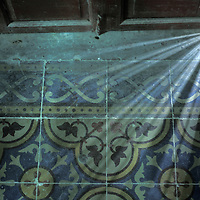 Asia, Vietnam, Hué, Light passes through doorway inside The Citadel in the old Imperial Enclosure