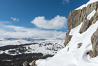 This snow covered wall is on the west side of Peak 10215 in the Bighorn Mountains. Loaf Mountain can be seen in the distance.
