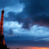 Europe, France, Paris. Eiffel Tower against a stormy sky.