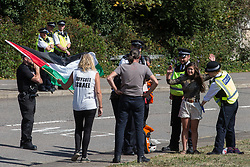 London, UK. 5 September, 2019. Metropolitan Police officers carry out a stop and search on an activist on the fourth day of a week-long carnival of resistance against DSEI, the world's largest arms fair.
