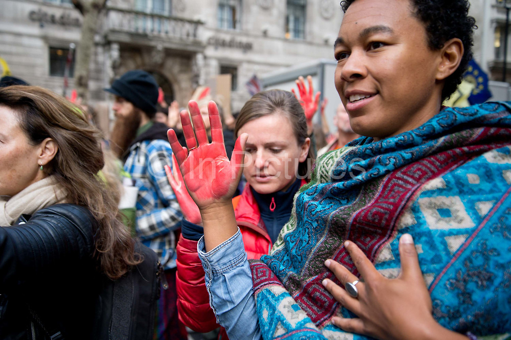 Protesters take part in the last day of two weeks of protests organised by Extinction Rebellion to draw attention to the climate emergency on October 18th in Westminster, London. Many activists painted their hands red and where possible left hand prints although a strong police presence made this difficult.
