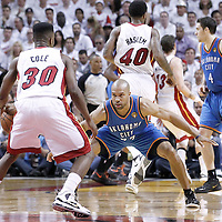21 June 2012: Oklahoma City Thunder point guard Derek Fisher (37) defends on Miami Heat point guard Norris Cole (30) during the Miami Heat 121-106 victory over the Oklahoma City Thunder, in Game 5 of the 2012 NBA Finals, at the AmericanAirlinesArena, Miami, Florida, USA. The Miami Heat wins the series 4-1.