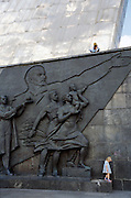 Young woman and child by Monument to the Conquerors of Space, Moscow, Russia