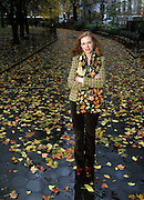 With her auburn hair and wearing fall colors, author Kaye Gibbons blends into the last leaves of fall as she visits a park in New York City during a book tour.