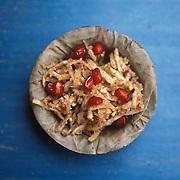 'Farari Chevada' - a potato dish decorated with pomegranate in Ahmedabad, Gujarat.