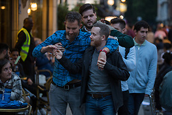 © Licensed to London News Pictures.  30/07/2021. London, UK. Despite rainy weather forecasts, revellers hit the streets of Soho in central London.  Photo credit: Marcin Nowak/LNP