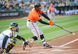 May 5, 2018 - Oakland, CA, U.S. - OAKLAND, CA - MAY 05: Baltimore Orioles center fielder Adam Jones (10) tries to connect on the ball during the regular season game between the Oakland Athletics and the Baltimore Orioles on May 5, 2018 at Oakland-Alameda County Coliseum in Oakland,CA (Photo by Samuel Stringer/Icon Sportswire) (Credit Image: © Samuel Stringer/Icon SMI via ZUMA Press)