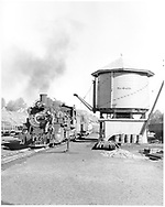 """D&RGW #492 passing the water tank as it arrives in Durango with a freight.<br /> D&RGW  Durango, CO  Taken by Krause, John<br /> In book """"Durango: Always a Railroad Town (1st ed.)"""" page 57"""