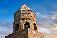 Pictures & images of Gergeti Holy Trinity (Tsminda Sameba) Georgian Orthodox and Apostolic Church bell tower, 14th century, Gergeti, Khevi province, Georgia (country). At Sunset. .<br /> <br /> Visit our MEDIEVAL PHOTO COLLECTIONS for more   photos  to download or buy as prints https://funkystock.photoshelter.com/gallery-collection/Medieval-Middle-Ages-Historic-Places-Arcaeological-Sites-Pictures-Images-of/C0000B5ZA54_WD0s<br /> <br /> Visit our REPUBLIC of GEORGIA HISTORIC PLACES PHOTO COLLECTIONS for more photos to browse, download or buy as wall art prints https://funkystock.photoshelter.com/gallery-collection/Pictures-Images-of-Georgia-Country-Historic-Landmark-Places-Museum-Antiquities/C0000c1oD9eVkh9c