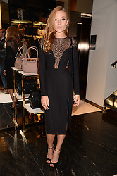 CLARA PAGET at a party hosted by Gucci & Clara Paget to drink a new cocktail 'I Bamboo You' held at Gucci, 34 Old Bond Street, London on 16th October 2013.