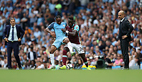 Football - Raheem Sterling of Manchester City and Arthur Masuaku of West Ham during the match at the Etihad Stadium between Manchester City and West Ham United. <br /> <br /> <br /> 2016 / 2017 Premier League - Manchester City vs. West Ham United<br /> <br /> -- at The Etihad Stadium.<br /> <br /> COLORSPORT/LYNNE CAMERON