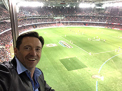 """Hugh Jackman releases a photo on Twitter with the following caption: """"""""Go Swans #AFLDonsSwans @AFL"""""""". Photo Credit: Twitter *** No USA Distribution *** For Editorial Use Only *** Not to be Published in Books or Photo Books ***  Please note: Fees charged by the agency are for the agency's services only, and do not, nor are they intended to, convey to the user any ownership of Copyright or License in the material. The agency does not claim any ownership including but not limited to Copyright or License in the attached material. By publishing this material you expressly agree to indemnify and to hold the agency and its directors, shareholders and employees harmless from any loss, claims, damages, demands, expenses (including legal fees), or any causes of action or allegation against the agency arising out of or connected in any way with publication of the material."""