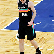 ORLANDO, FL - APRIL 12: Jakob Poeltl #25 of the San Antonio Spurs walks up the court against the Orlando Magic at Amway Center on April 12, 2021 in Orlando, Florida. NOTE TO USER: User expressly acknowledges and agrees that, by downloading and or using this photograph, User is consenting to the terms and conditions of the Getty Images License Agreement. (Photo by Alex Menendez/Getty Images)*** Local Caption *** Jakob Poeltl