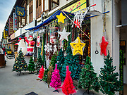 13 DECEMBER 2018 - SINGAPORE:  Christmas decorations for sale at a shop in the Geylang neighborhood. The Geylang area of Singapore, between the Central Business District and Changi Airport, was originally coconut plantations and Malay villages. During Singapore's boom the coconut plantations and other farms were pushed out and now the area is a working class community of Malay, Indian and Chinese people. In the 2000s, developers started gentrifying Geylang and new housing estate developments were built.     PHOTO BY JACK KURTZ