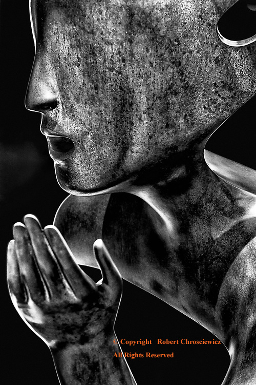 Blind Conversation (B&W): A dynamic metallic sculpture depicts the upper portion of a person, devoid of eyes, in conversation Plaza de San Francisco, Havana Cuba.