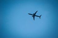 2018 APRIL 30 - An Alaska Airlines plane flies over downtown, Seattle, WA, USA. By Richard Walker