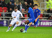 England's Patrick Roberts looks to get past Italy's Arturo Calabresi, centre and Italy's Alessio Lo Porto, right<br /> <br /> Photographer Andrew Vaughan/CameraSport<br /> <br /> U19 International Football Friendly - England U19 v Italy U19 - Friday 14th November - New York Stadium - Rotherham<br /> <br /> © CameraSport - 43 Linden Ave. Countesthorpe. Leicester. England. LE8 5PG - Tel: +44 (0) 116 277 4147 - admin@camerasport.com - www.camerasport.com