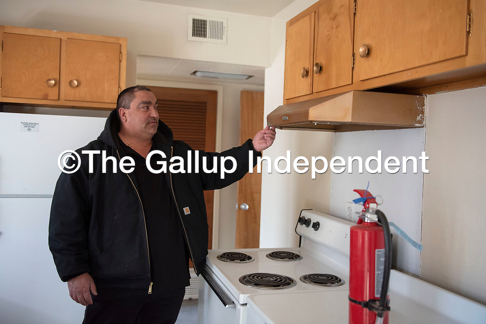 Mark Archuleta, director of support services at Zuni Public School District looks at old appliances in one of the units at the Twin Buttes Teacherage Thursday, Jan. 30 in Zuni Pueblo. The Twin Buttes Teacherage is the oldest of the three housing choices for teachers not from Zuni Pueblo.