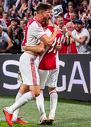 14-08-2018 NED: Champions League AFC Ajax - Standard de Liege, Amsterdam<br /> Third Qualifying Round,  3-0 victory Ajax during the UEFA Champions League match between Ajax v Standard Luik at the Johan Cruijff Arena / Klaas Jan Huntelaar #9 of Ajax celebrates his first goal 1-0 with nicolas Tagliafico #31 of Ajax