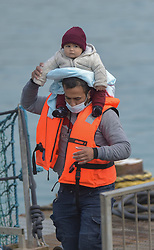 © Licensed to London News Pictures. 17/09/2021. Dover, UK.  Migrants arrive at Dover Harbour in Kent. Migrants are continuing to attempt the crossing from France as the weather improves this week. Photo credit: Stuart Brock/LNP