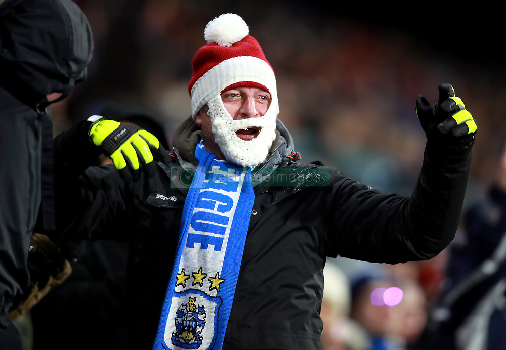 A Huddersfield Town fan in the stands during the Premier League match at the John Smith's Stadium, Huddersfield.