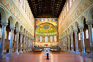 View of the interior of the 6th century AD Byzantine Roman Mosaics of the Basilica of Sant'Apollinare in Classe, Ravenna Italy, looking towards the Apse mosaics. A UNESCO World Heritage Site. .<br /> <br /> Visit our BYZANTINE MOSAIC PHOTO COLLECTION for more   photos  to download or buy as prints https://funkystock.photoshelter.com/gallery/Byzantine-Eastern-Roman-Style-Mosaics-Pictures-Images/G0000NvKCna.AoH4/3/C0000YpKXiAHnG2k<br /> <br /> If you prefer to buy from our ALAMY PHOTO LIBRARY  Collection visit : https://www.alamy.com/portfolio/paul-williams-funkystock/san-apollinaire-classe-ravenna.html
