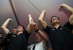Sebastjan Skube of Cimos Koper, Jure Dobelsek of Cimos Koper and fans celebrate  after the handball match between RK Cimos Koper (SLO) and SL Benfica (POR) in return final match of EHF Challenge Cup, on May 22, 2011 in Tent at Arena Bonifika, Koper, Slovenia. Koper defeated Benfica 31-27 and became Euro Challenge Champion 2011. (Photo By Vid Ponikvar / Sportida.com)