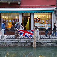 VENICE - ITALY - APRIL 29:  Final touches at a local tearoom on Rio Marin where will celebrate the Royal Wedding on April 29, 2011 in Venice, Italy. The wedding of Britain's Prince William and his fiancee Kate Middleton is being celebrated at Westminster Abbey in London on April 29, 2011.  (Photo by Marco Secchi)