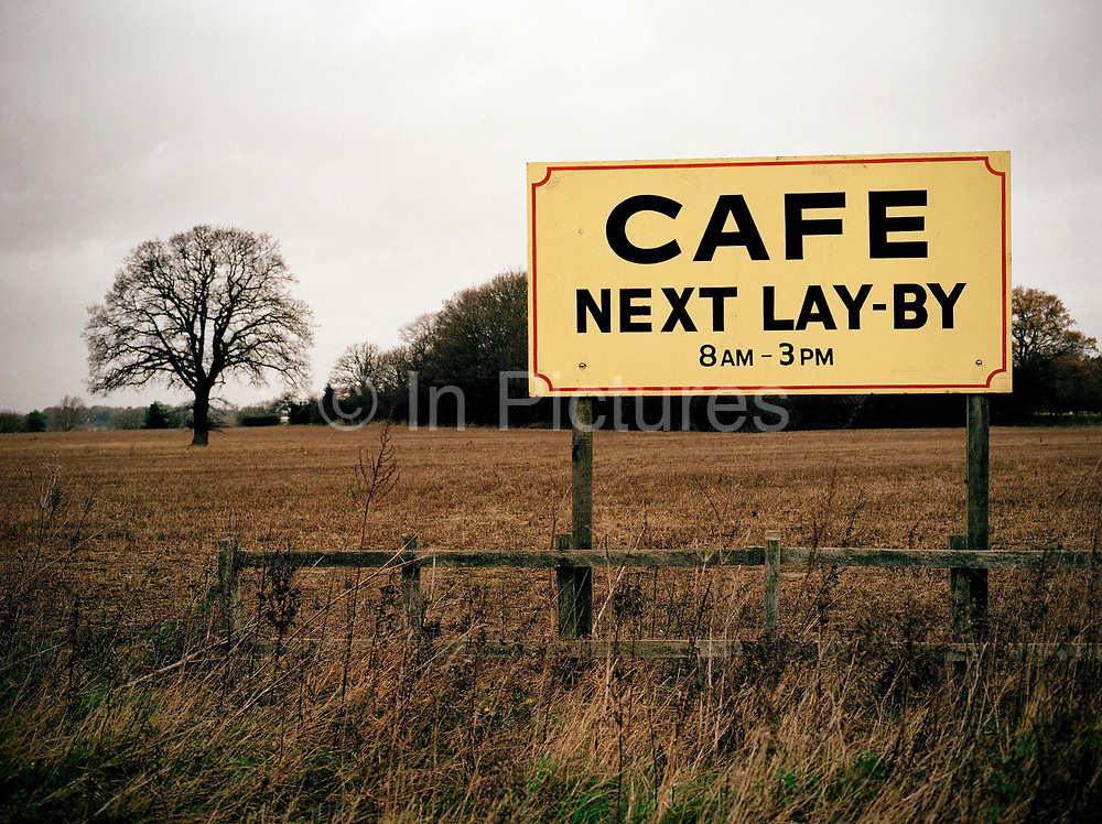 A roadside cafe sign promoting Dona's Cafe on the 10th November 2009 in Stratford St Mary in the United Kingdom.