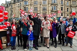 Pictured: Daniel Johnston (candidate) and Kezia Dugdale are joined by Scottish Labour supporters<br /> <br /> Scottish Labour leader, Kezia Dugdale began her Party's Holyrood election campaign by joining supporters at a street stall in Morningside in Edinburgh today. She was joned by local candidate Daniel Johnston<br /> <br />  Ger Harley | EEm 23 March 2016