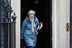 London, UK. 13th March, 2019. Prime Minister Theresa May leaves 10 Downing Street following an emergency Cabinet meeting to attend Prime Minister's Questions the day after her proposed final Brexit withdrawal agreement was defeated in the House of Commons by a majority of 149 votes, the second time that the draft agreement had been rejected by MPs by a very substantial majority.