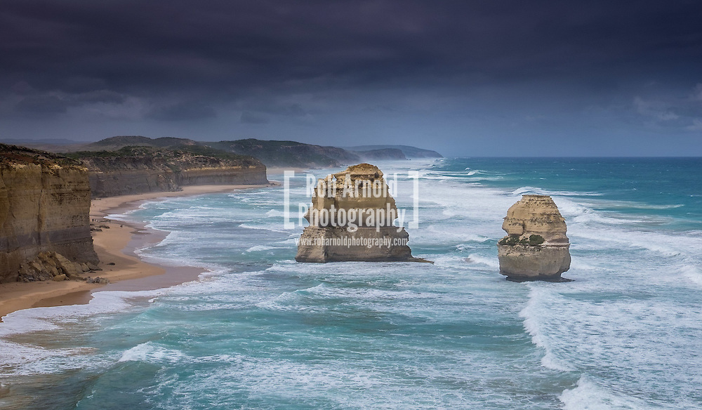 Stormy seas crash into the two huge sea stacks, Gog and MaGog along the Great Ocean Road near Port Campbell in Victoria.