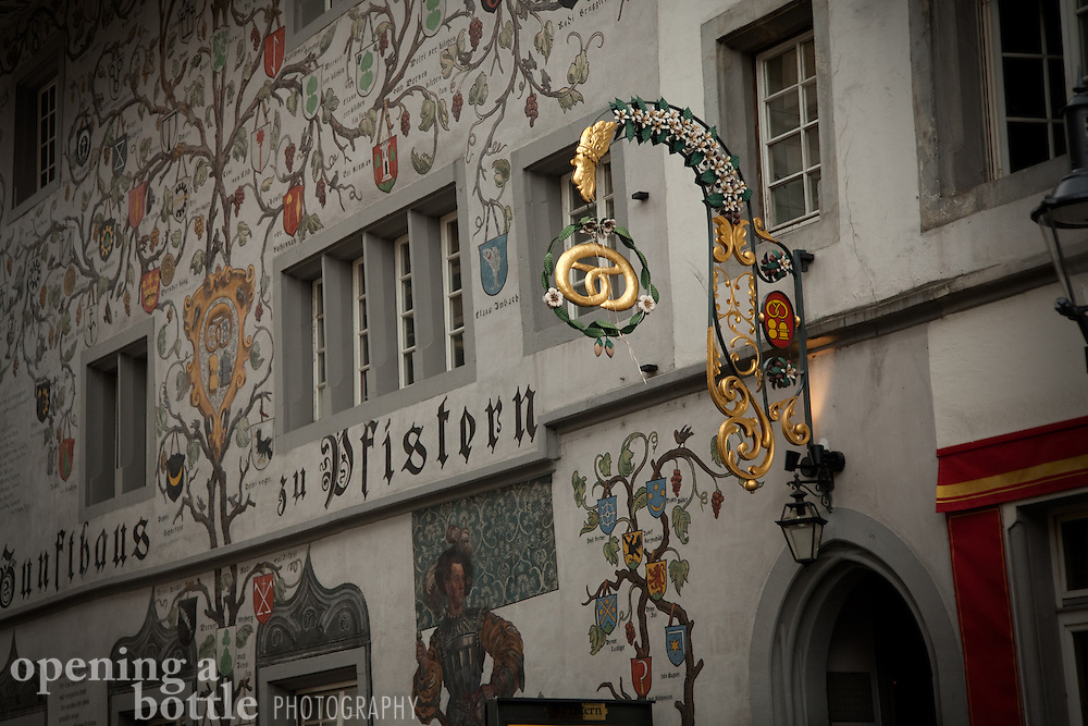 Decorative signage covers a building in Lucerne, Switzerland.
