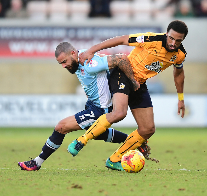 Blackpool's Kyle Vassell vies for possession with Cambridge United's Leon Legge<br /> <br /> Photographer Chris Vaughan/CameraSport<br /> <br /> The EFL Sky Bet League Two - Cambridge United v Blackpool - Saturday 14th January 2017 - The Cambs Glass Stadium - Cambridge<br /> <br /> World Copyright © 2017 CameraSport. All rights reserved. 43 Linden Ave. Countesthorpe. Leicester. England. LE8 5PG - Tel: +44 (0) 116 277 4147 - admin@camerasport.com - www.camerasport.com