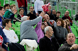 Spectators during handball match between RK Krim Mercator and Buducnost Podgorica (MNE) in season 2011/2012 of EHF Women's Champions League, on February 24, 2012 in Arena Stozice, Ljubljana, Slovenia. Buducnost defeated Krim 27-26. (Photo By Vid Ponikvar / Sportida.com)